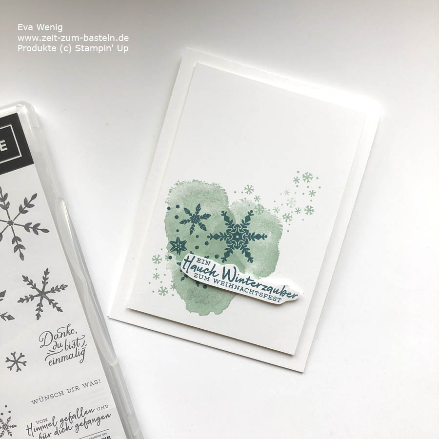 Weihnachtskarte mit Schneeflockenwünsche